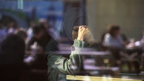 Sad Muslim female in cafe suffering loneliness, emigration problems, divorce. Stock photo royalty free stock photos