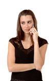 Sad News. Woman gets some serious sad news on her cell phone Stock Images