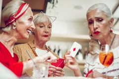 Sad nice aged woman loosing the game. I lost. Sad aged women holding her card while losing the game stock photo