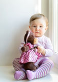 Sad nice baby girl with toy bear Stock Images