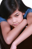 Sad nine year old girl. Sitting on chair, bored Royalty Free Stock Photos