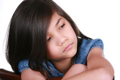 Sad nine year old girl Stock Photos