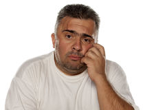 Sad obese man. Portrait of a sad obese man leaning on his hand Royalty Free Stock Images