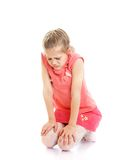 Sad, offended little girl sitting on the floor Royalty Free Stock Photo