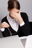 Sad office worker. Sad and tired office woman Stock Photo