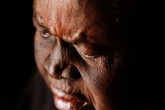 A sad old African woman in deep thought royalty free stock photography