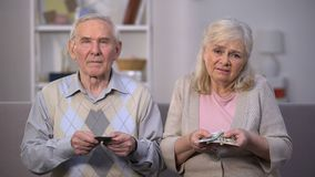 Sad old couple counting pension benefit, social insecurity, lack of money stock video footage