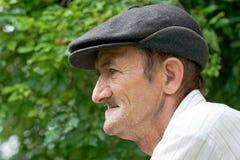 Sad old man. Profile of a sad old man outdoors Stock Image