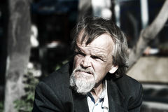 Sad homeless old man Royalty Free Stock Photos
