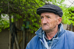 Sad old man. Retired man outdoors royalty free stock photography