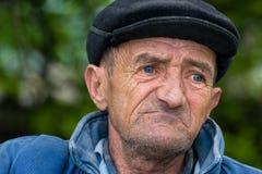 Sad old man. Retired man outdoors Stock Photos
