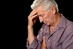 Sad old man on a black Royalty Free Stock Images