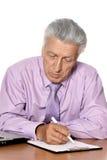 Sad old man sitting on a background. Writing stock photo