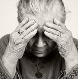 Sad old senior woman with health problems
