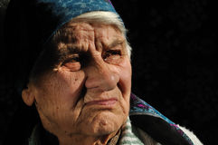 The sad, old woman, looking away Royalty Free Stock Images