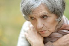 Sad old woman Stock Images
