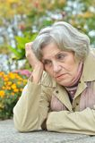 Sad old woman in park Royalty Free Stock Images