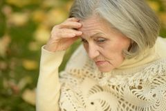 Sad old woman in park Royalty Free Stock Photo
