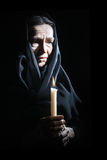 Sad old woman Senior in sorrow with candle. Sad old woman Senior woman in sorrow with candle depressed portrait Royalty Free Stock Photos
