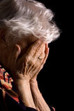Sad Old Women. Sad Old Woman with her hands to her face is dismay royalty free stock photos
