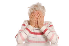 Sad Old Women with her hands to her face is dismay. On white stock photo