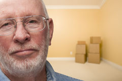 Sad Older Man In Empty Room with Boxes stock image