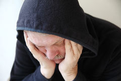 Sad older man in hooded jacket Royalty Free Stock Images