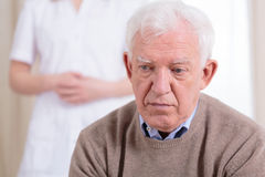 Sad older man stock photo