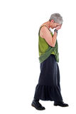 Sad Older Woman Stands With Head Down Royalty Free Stock Image