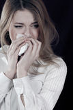 Sad or in Pain crying beautiful young woman Stock Photo