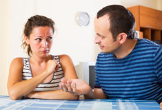 Sad partner asking forgiveness. Sad partner asking another for forgiveness at home royalty free stock image