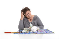 Sad pensioner with money problems. Standard of living for older Royalty Free Stock Photos