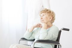 Sad pensioner in wheelchair Royalty Free Stock Image