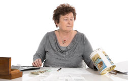 Sad pensioner woman have money problems - poverty in the age. Royalty Free Stock Images