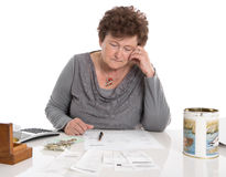Sad pensioner woman have money problems - poverty in the age. Stock Photo