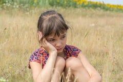 Sad and pensive girl Stock Images