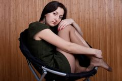Sad pensive girl in torn tights Stock Images