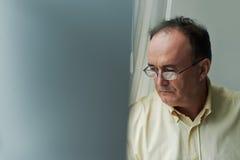 Sad pensive man stock images
