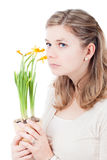 Sad pensive woman smelling at flowers Royalty Free Stock Image
