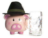 Sad piggy bank wearing beer festival hat and empty pint Royalty Free Stock Photo
