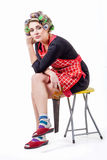 Sad pinup housewife sitting with hacksaw Stock Photo