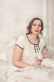 Sad plus size woman sitting in the bed Royalty Free Stock Images