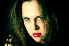 Sad portrait. Portrait of sad female with green eyes and red lips Royalty Free Stock Photos