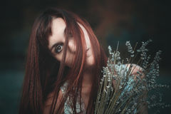 Sad portrait of red haired woman Stock Photo