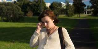 Sad pregnant. Crying woman in park Stock Images