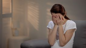 Sad pregnant woman crying, suffering prenatal depression, single motherhood stock photo