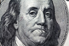 The sad president of America. Close up photo of the president from hundred American dollars with a sad smile (expression of the person Stock Image