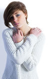 Sad pretty brunette looking at camera with arms crossed Stock Image