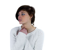Sad pretty brunette thinking with arms crossed Royalty Free Stock Images