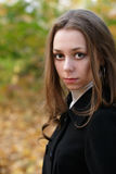 Sad pretty girl in fall park. Portrait of a sad pretty girl in fall outdoor Stock Photo